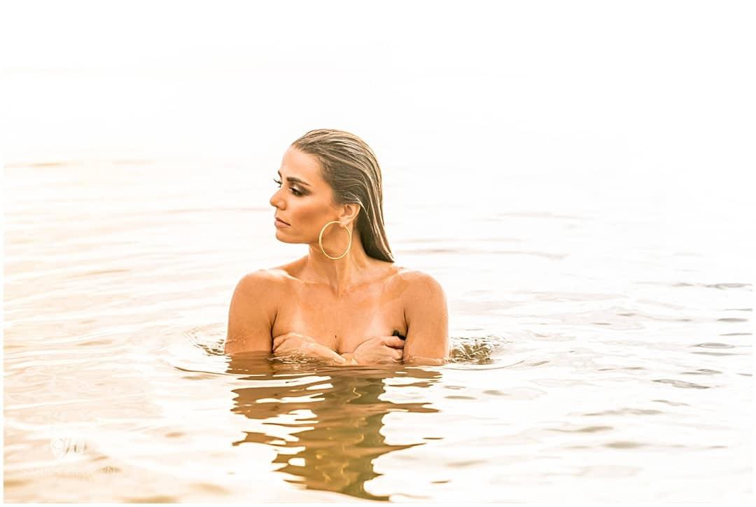 Sexy sunrise woman on boneyard beach at her Glamorous photography session.