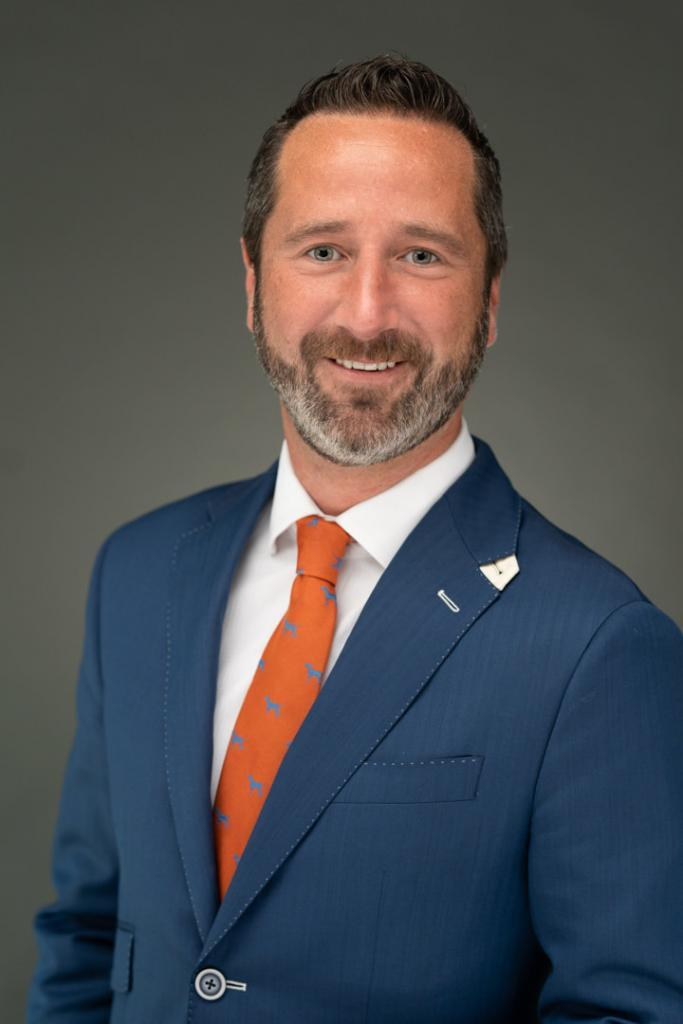 Guy with blue suit and orange tie with Jacksonville Headshot Photographer