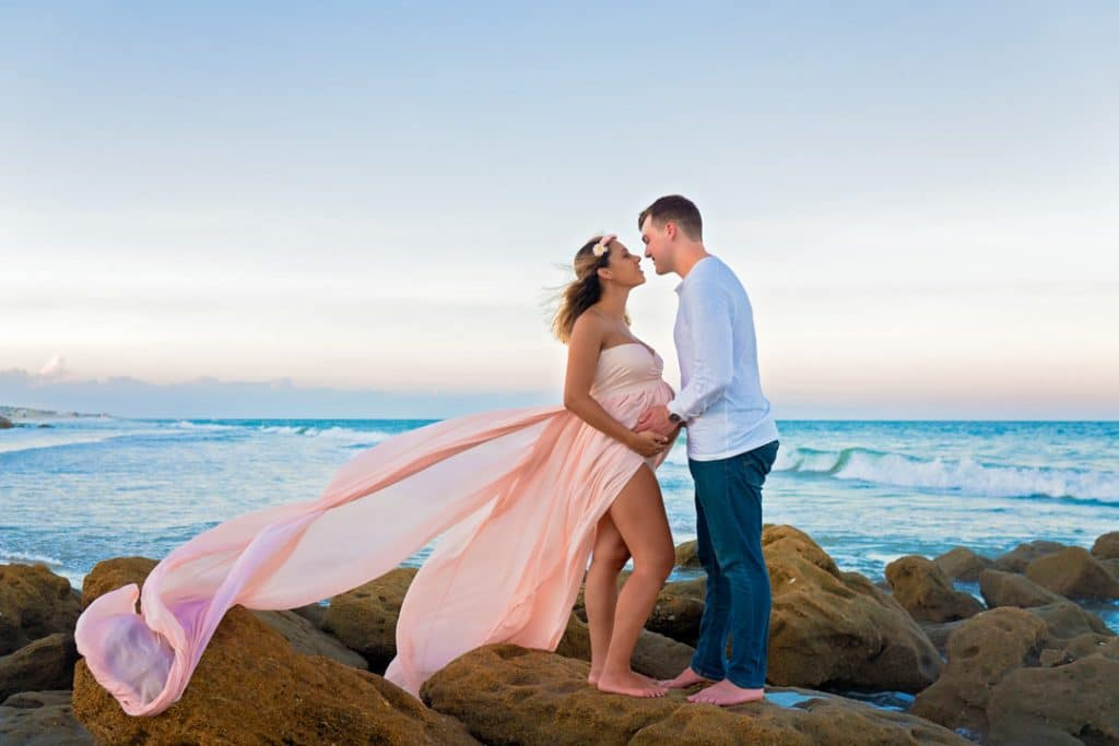 Mom and dad posing with baby bump with Jacksonville Maternity Photographer