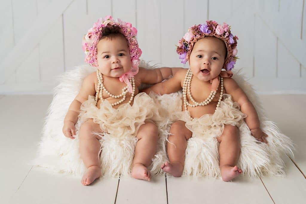 LIttle girls with flower hats posing for Jacksonville Family Photographer