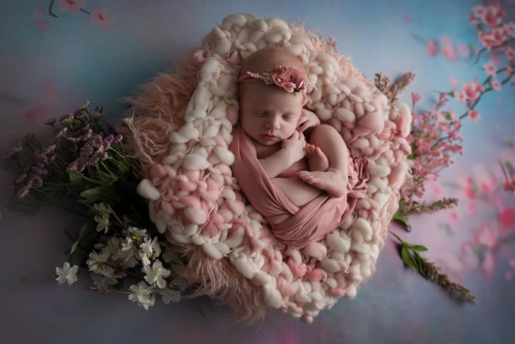 Jacksonville newborn session baby in bucket in pink with flowers
