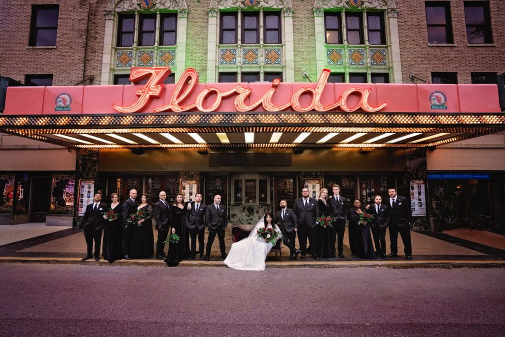 Wedding Party posing at the florida theater their Wedding at Jacksonville Public Library