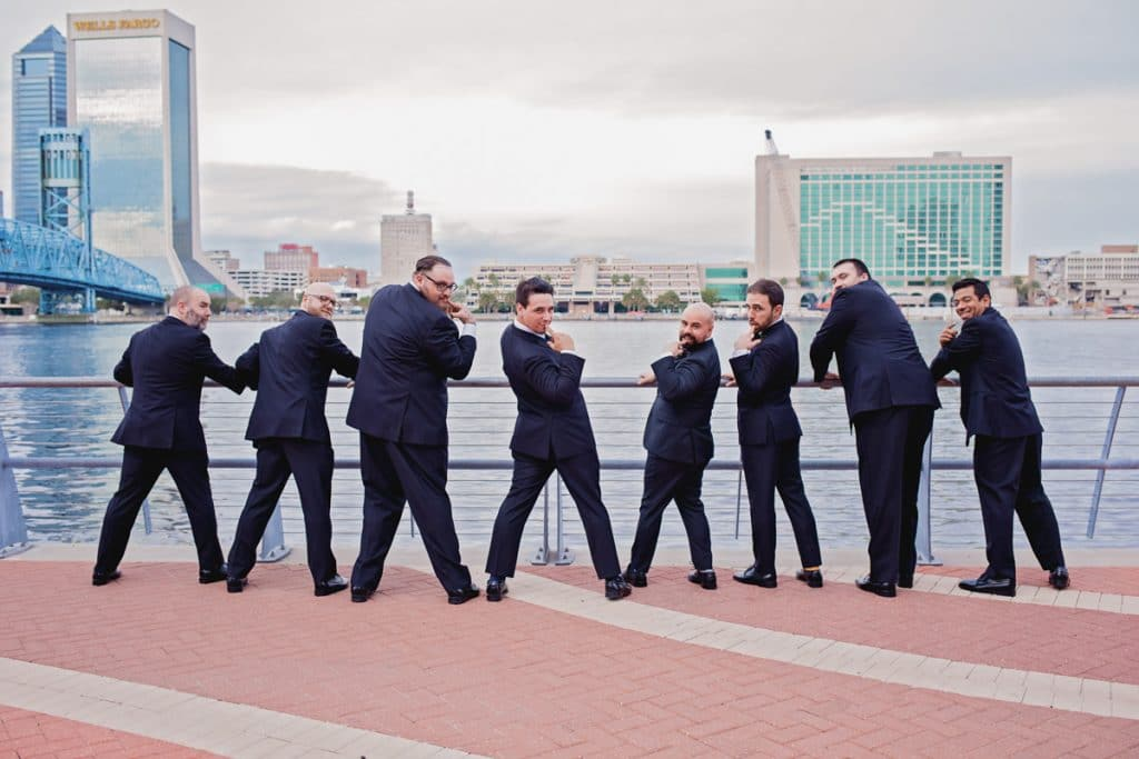 Groom funny pose their Wedding at Jacksonville Public Library