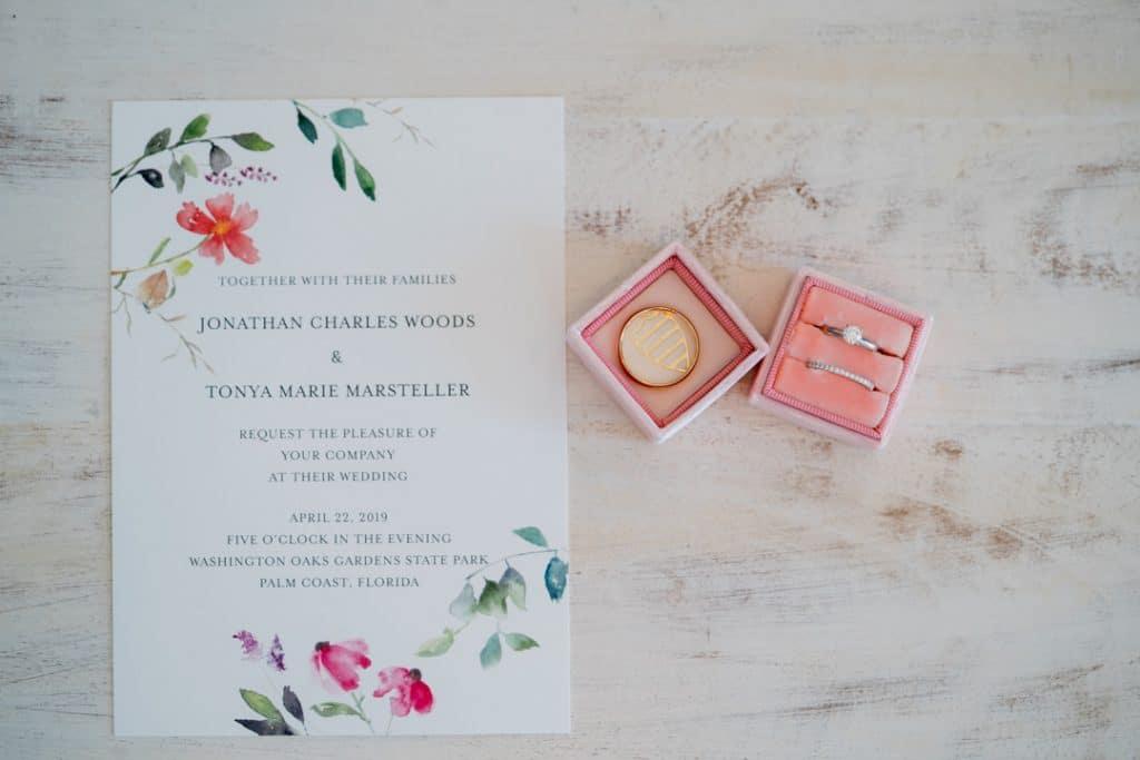 Wedding ring and invitation at Tonya and Jon's Washington Oaks State Park Wedding