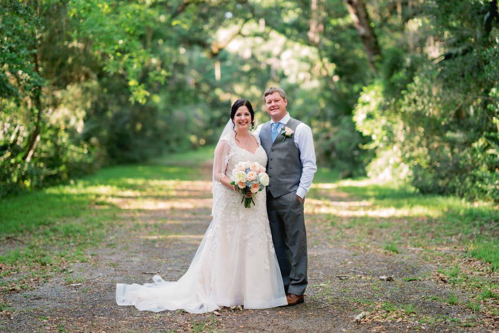 Bride and groom posing in road at Tonya and Jon's Washington Oaks State Park Wedding