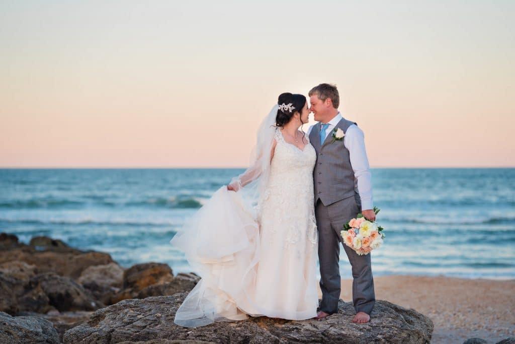 Brie and groom kiss at sunset on beach at Tonya and Jon's Washington Oaks State Park Wedding
