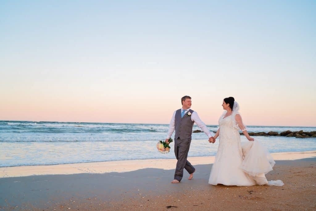 Bride and Groom walking on Beach at Tonya and Jon's Washington Oaks State Park Wedding