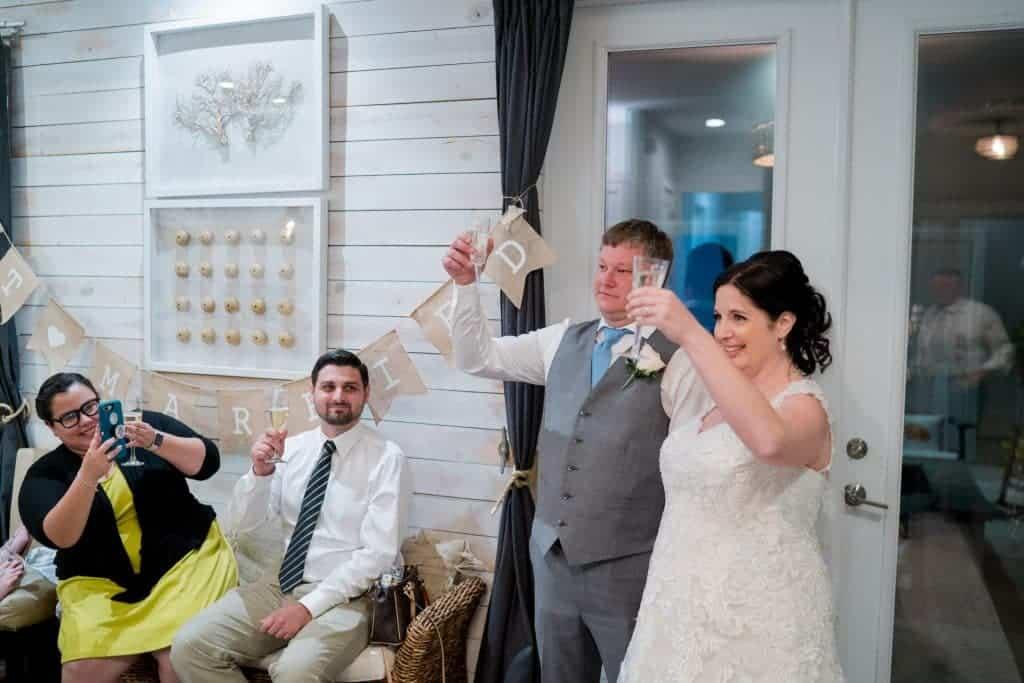 Bride and groom toast at reception at Tonya and Jon's Washington Oaks State Park Wedding