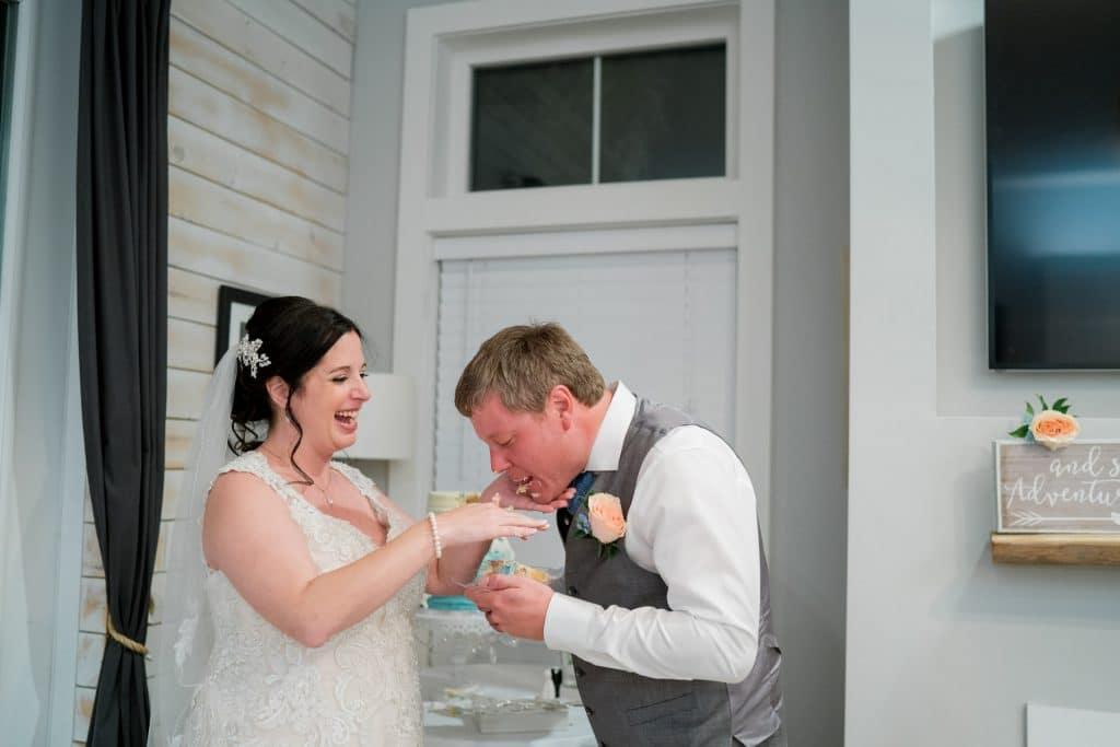 Bride feeding groom cake at Tonya and Jon's Washington Oaks State Park Wedding