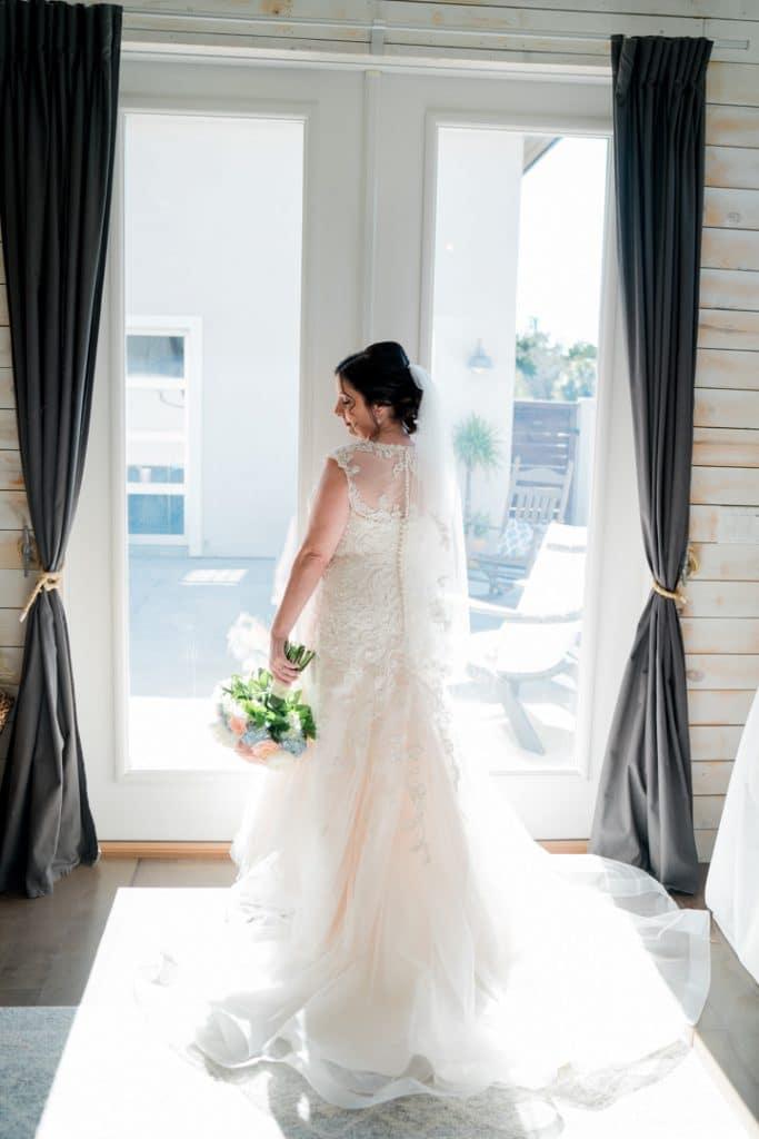 Bride posing in window at Tonya and Jon's Washington Oaks State Park Wedding