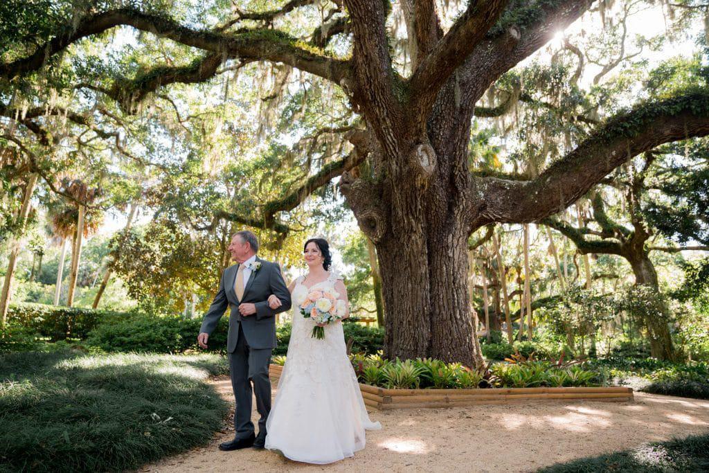 Bride walking with father down the aisle at Tonya and Jon's Washington Oaks State Park Wedding