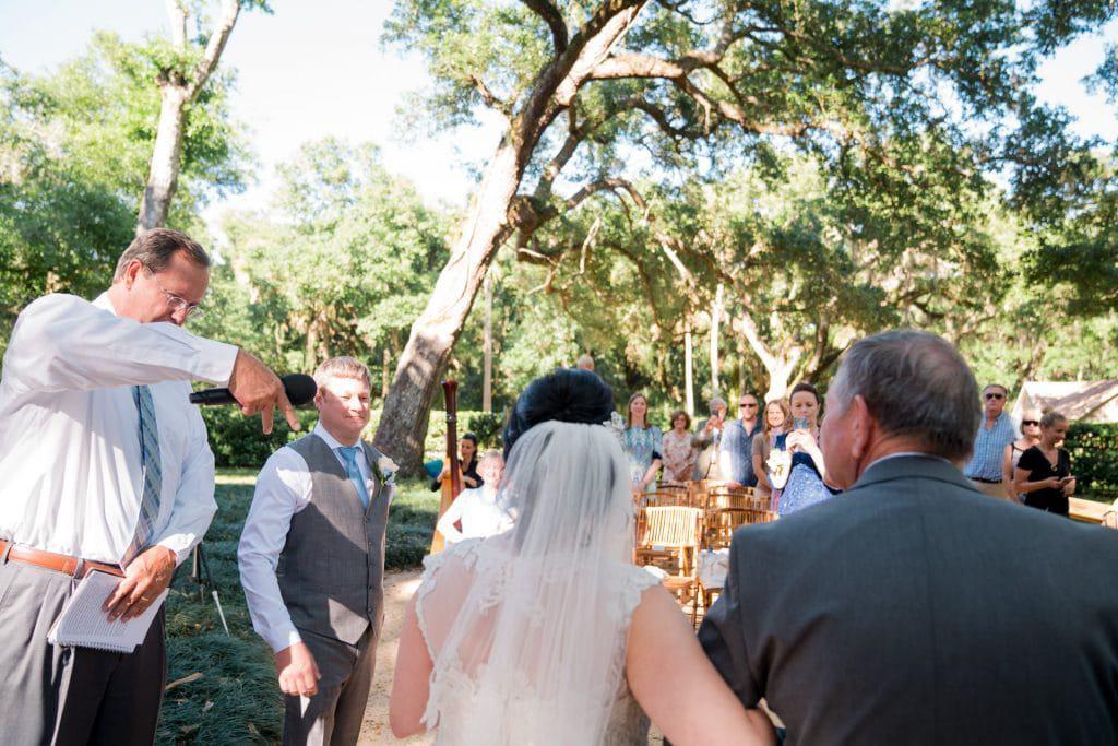 Groom sees bride walking down the aisle at Tonya and Jon's Washington Oaks State Park Wedding