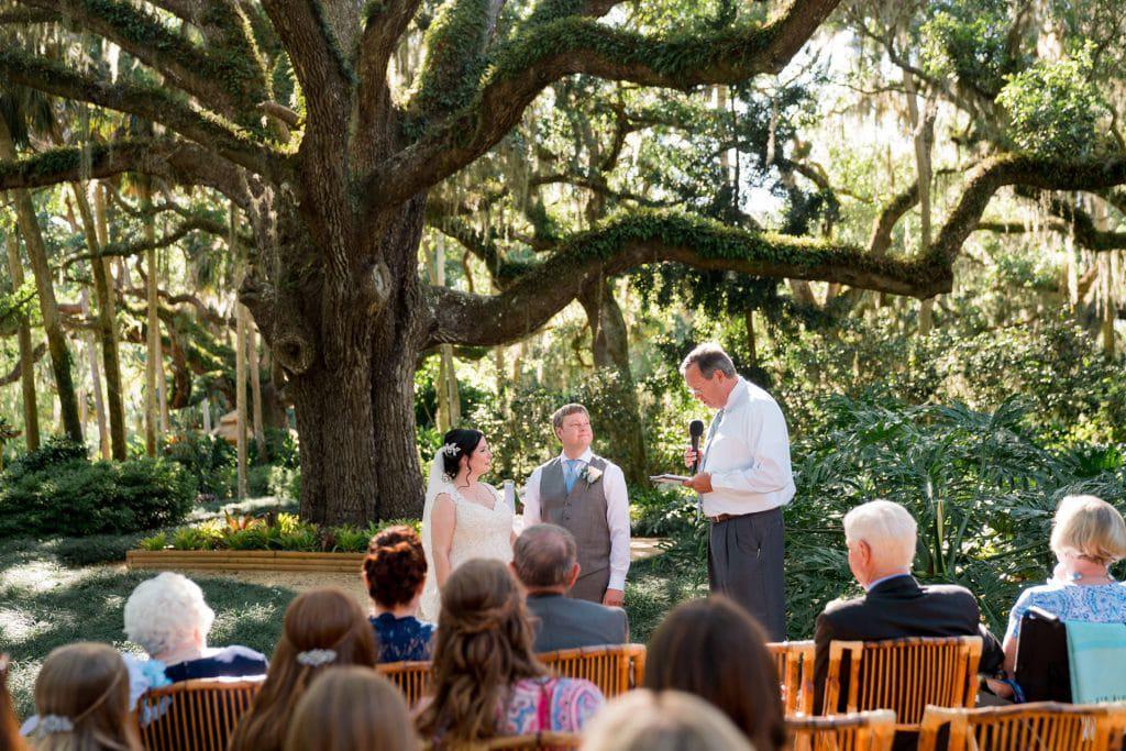 Wedding ceremony under tree at Tonya and Jon's Washington Oaks State Park Wedding