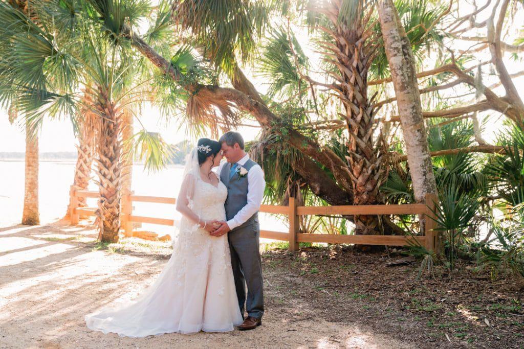 Bride and groom posing at sunset at Tonya and Jon's Washington Oaks State Park Wedding