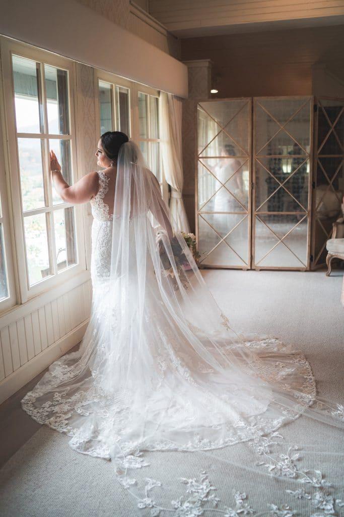Bride posing at window. at Ari and Ryan's Pippin Hill Farms Wedding.