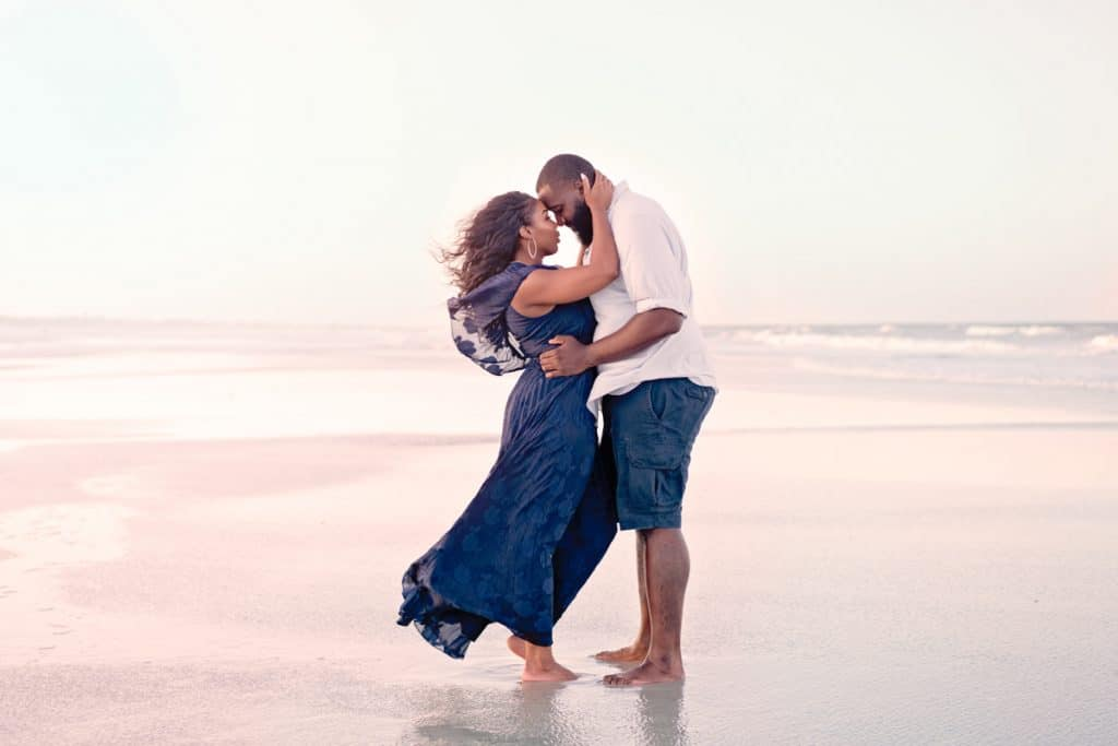 Couple with blue dress on beach with Jacksonville's best Engagement Photographer.