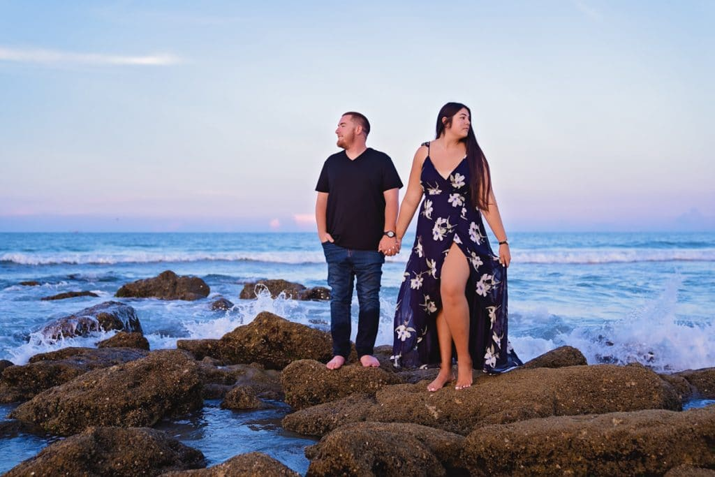 Couple posing on beach with Jacksonville's best Engagement Photographer.
