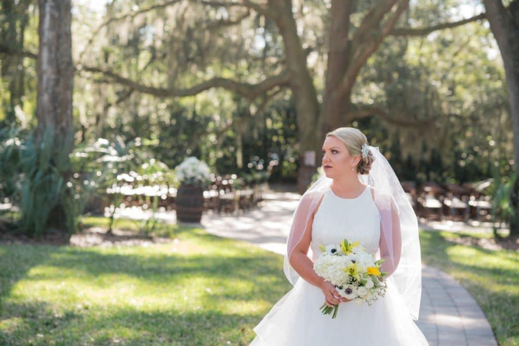 Bride posing at Amber and Garvey's wedding at Bowing Oaks.