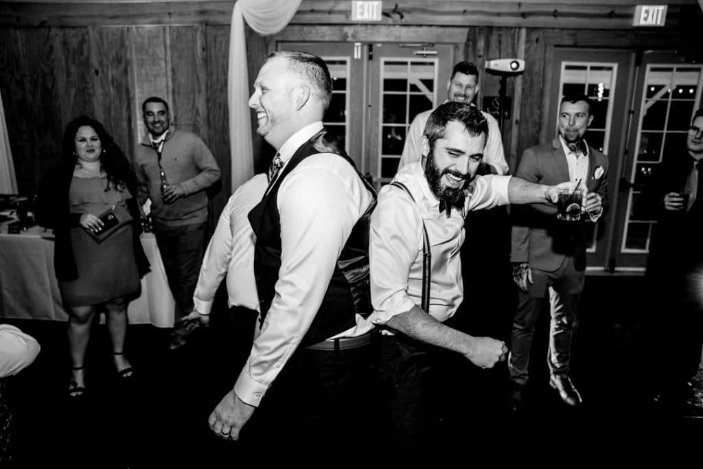 Fun dancing at reception at Amber and Garvey's wedding at Bowing Oaks.