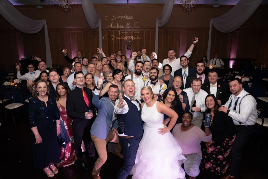 Group shot at reception at Amber and Garvey's wedding at Bowing Oaks.