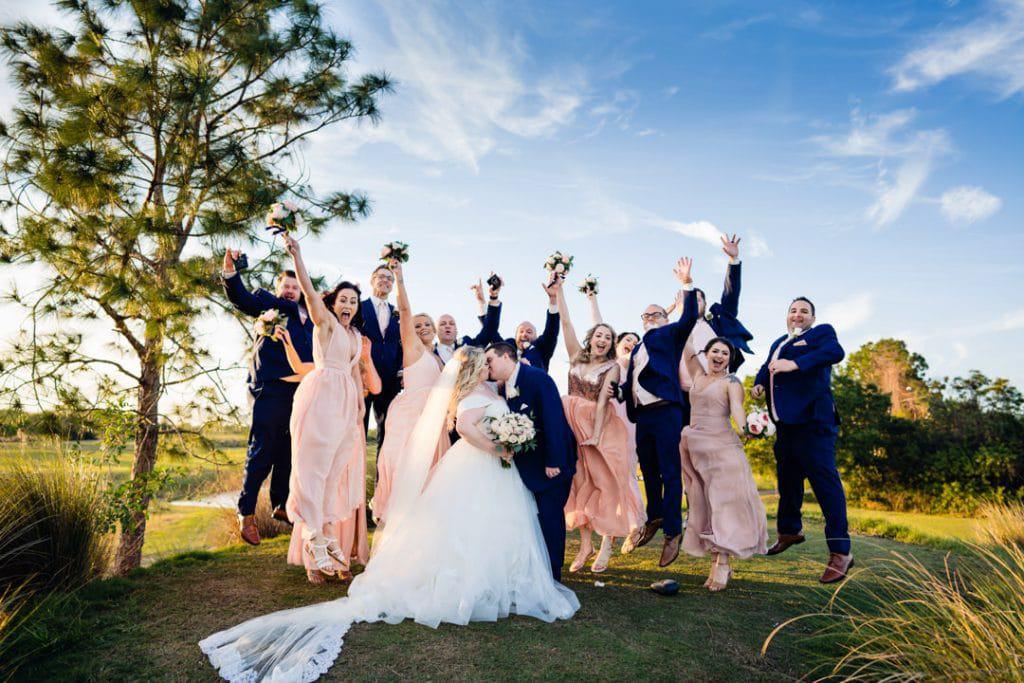 Wedding party jump shot at Ashley and Justin's Wedding at The Royal Crest Room.