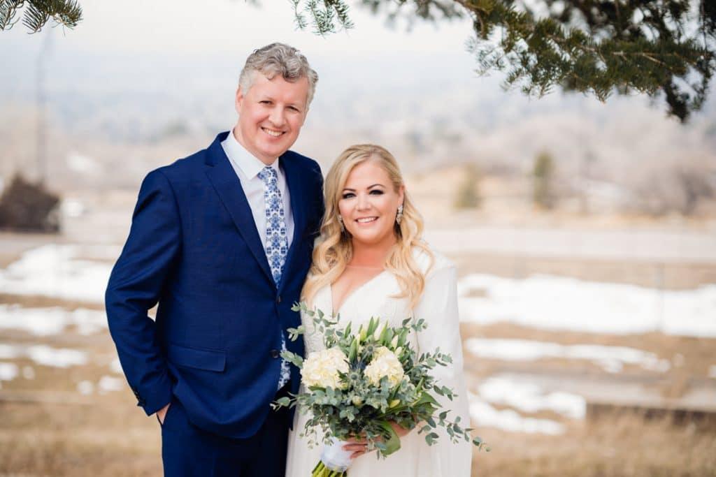 Bride and groom smiling at camera at Heather and Jelmer's Utah Wedding