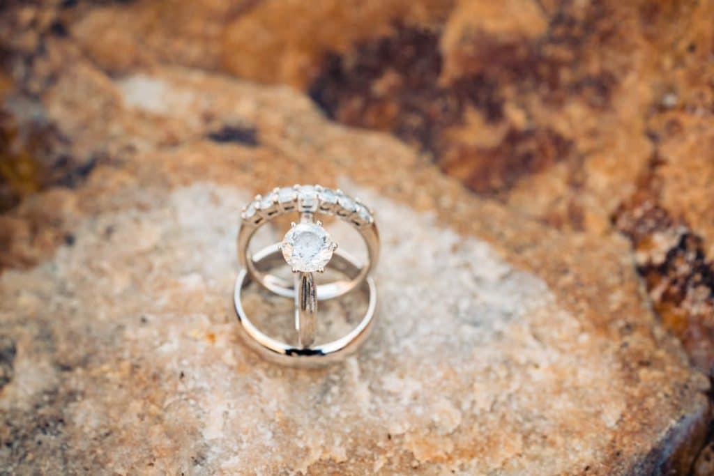 Wedding rings on stone at Heather and Jelmer's Utah Wedding