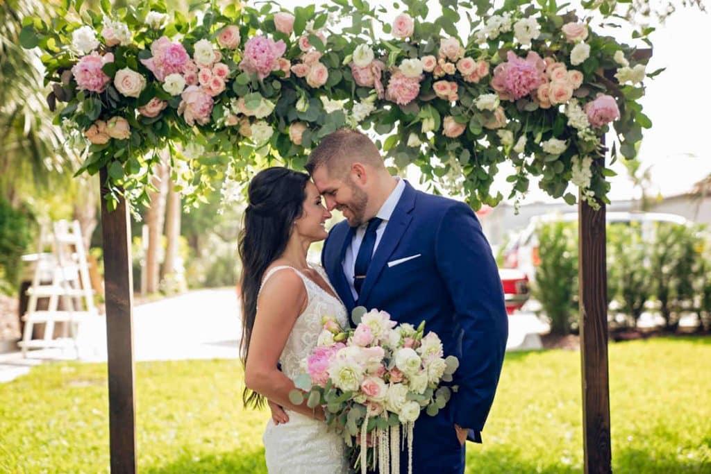 Bride and groom posing at Brooke and Josh's New Smyrna Beach Wedding