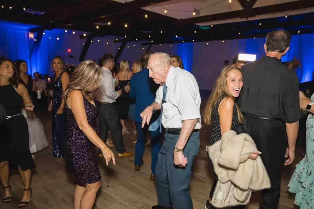 Grandpa dancing on the dance floor at Brooke and Josh's New Smyrna Beach Wedding