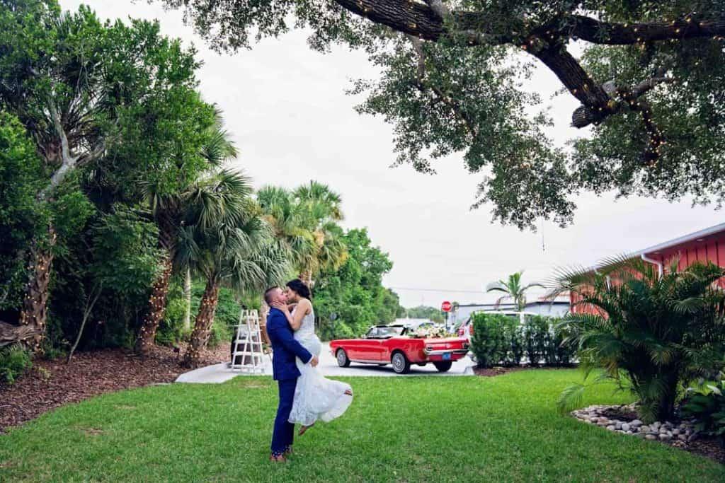 Groom lifting bride at Brooke and Josh's New Smyrna Beach Wedding