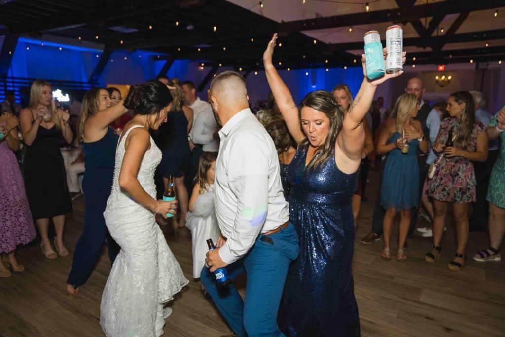 Bridesmaid dancing at Brooke and Josh's New Smyrna Beach Wedding