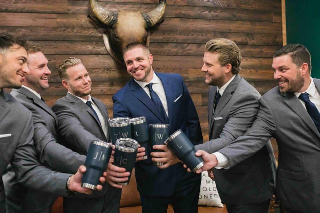 Groom cheering with his groomsmen at Brooke and Josh's New Smyrna Beach Wedding