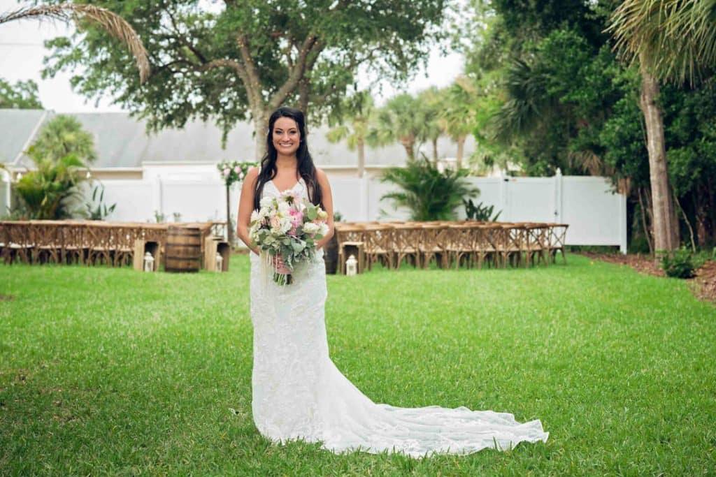 Bride posing at Brooke and Josh's New Smyrna Beach Wedding